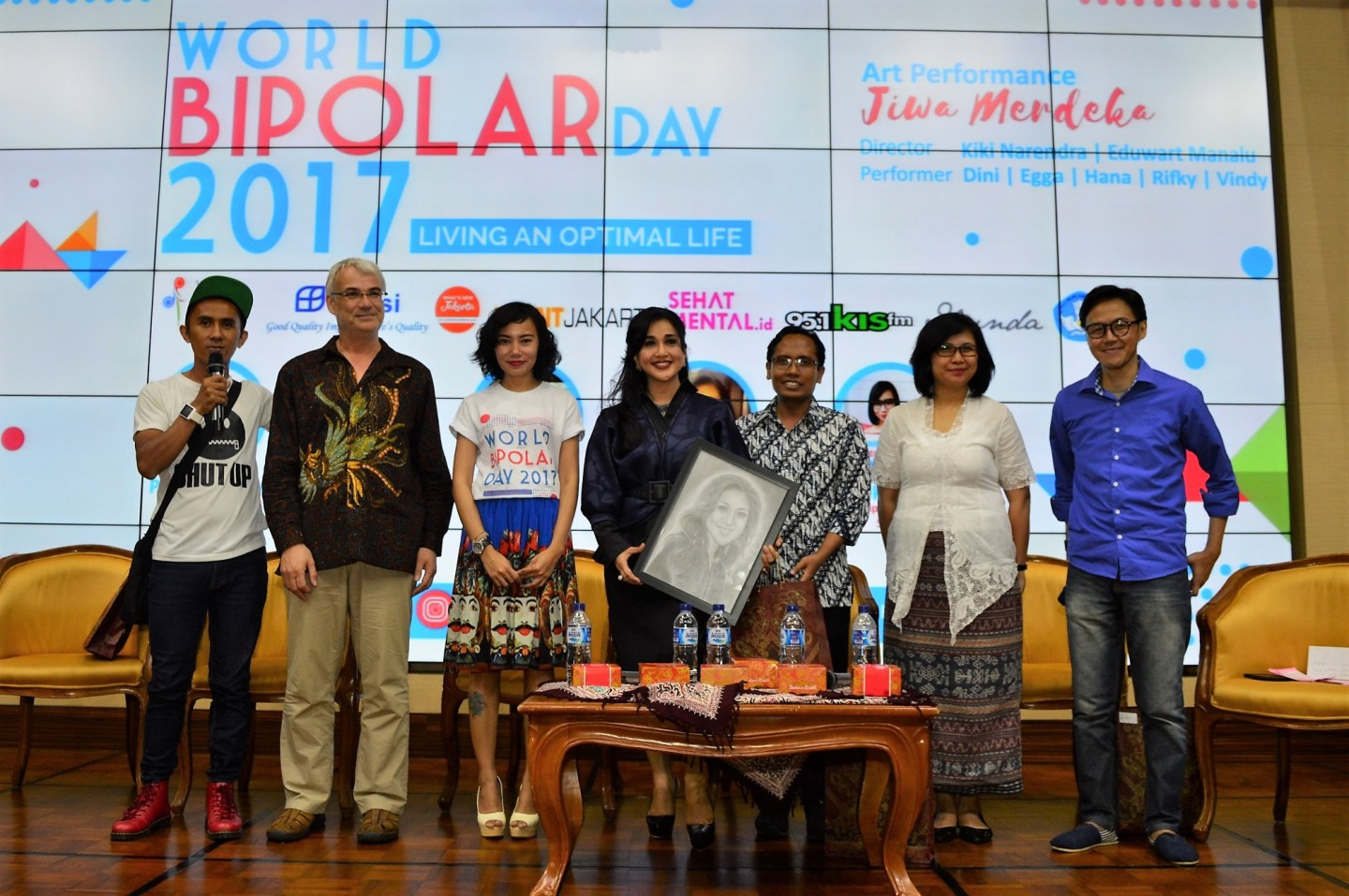 Some people standing on stage of World Bipolar Day event